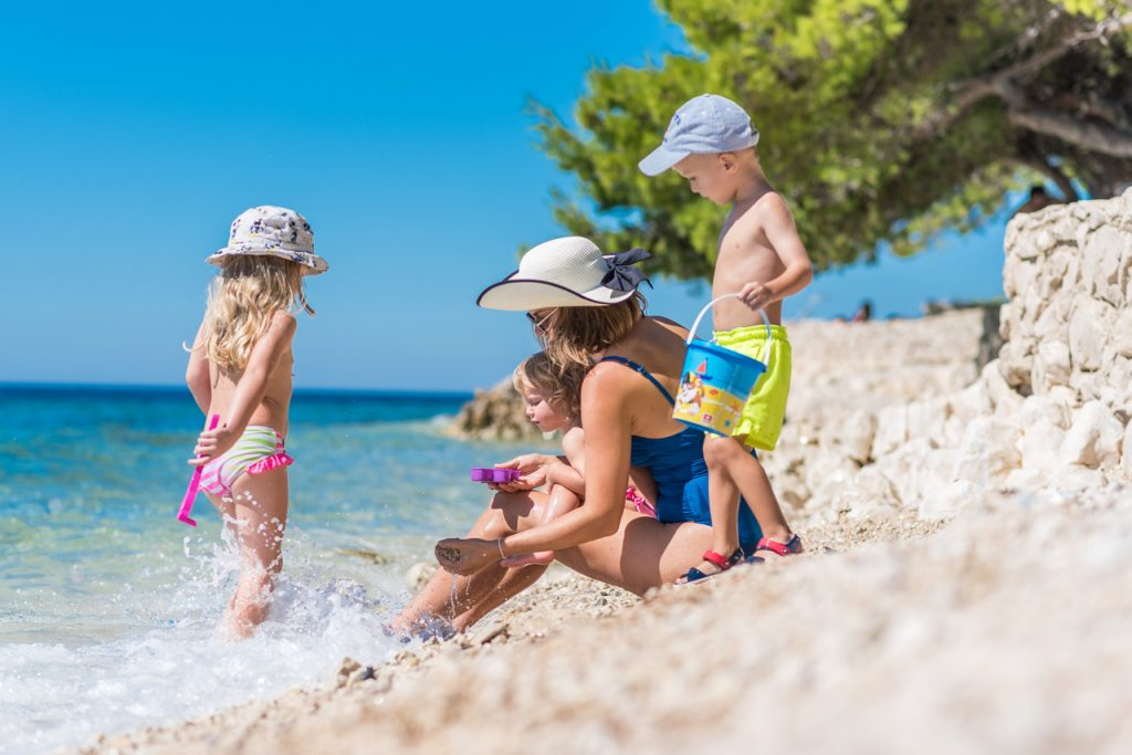 Playing with children on the beach in Petrčane